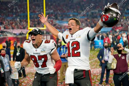 Tampa Bay Buccaneers tight end Rob Gronkowski (87), left, and Tampa Bay Buccaneers quarterback Tom Brady (12) celebrate together after the NFL Super Bowl 55 football game against the Kansas City Chiefs, in Tampa, Fla. The Tampa Bay Buccaneers defeated the Kansas City Chiefs 31-9