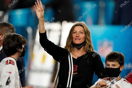 Gisele Bundchen waves out to the crowd after the NFL Super Bowl 55 football game between the Tampa Bay Buccaneers and the Kansas City Chiefs, in Tampa, Fla. The Tampa Bay Buccaneers defeated the Kansas City Chiefs 31-9