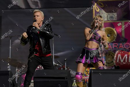 Stock Picture of Miley Cyrus performs with Billy Idol at the TikTok Tailgate concert for local medical personnel, in Tampa, Fla