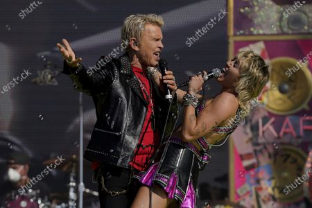 Stock Image of Miley Cyrus performs with Billy Idol at the TikTok Tailgate concert for local medical personnel, in Tampa, Fla
