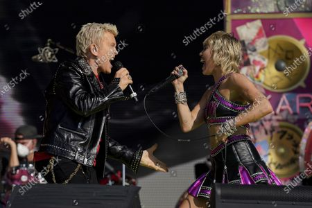 Miley Cyrus performs with Billy Idol at the TikTok Tailgate concert for local medical personnel, in Tampa, Fla