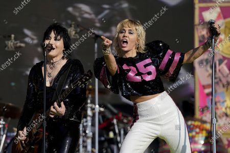 Miley Cyrus performs with Joan Jett at the TikTok Tailgate concert for local medical personnel, in Tampa, Fla