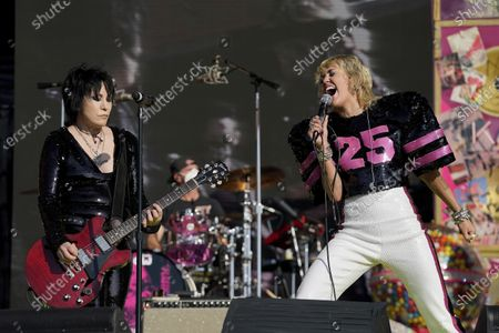 Stock Photo of Miley Cyrus performs with Joan Jett at the TikTok Tailgate concert for local medical personnel, in Tampa, Fla