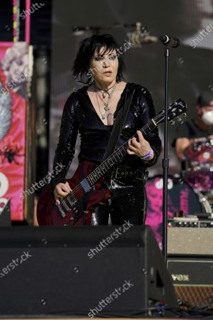 Joan Jett performs with Miley Cyrus at the TikTok Tailgate concert for local medical personnel, in Tampa, Fla
