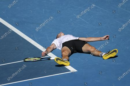 Marton Fucsovics of Hungary reacts after defeating Stan Wawrinka of Switzerland in the second round of the Australian Open Grand Slam tennis tournament in Melbourne, Australia, 10 February 2021.