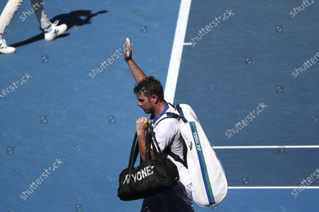 Stan Wawrinka of Switzerland waves at spectators after losing against Marton Fucsovics of Hungary in the second round of the Australian Open Grand Slam tennis tournament in Melbourne, Australia, 10 February 2021.