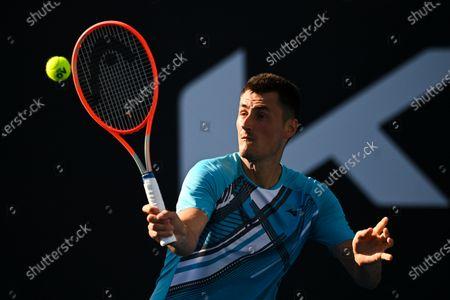 Bernard Tomic of Australia in action during his second Round Men's singles match against Denis Shapovalov of Canada on Day 3 of the Australian Open Grand Slam tennis tournament in Melbourne, Australia, 10 February 2021.