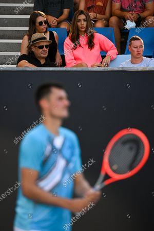 Vanessa Sierra reacts as she observes her boyfriend Bernard Tomic of Australia during his second Round Men's singles match against Denis Shapovalov of Canada on Day 3 of the Australian Open Grand Slam tennis tournament in Melbourne, Australia, 10 February 2021.