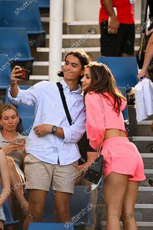 Vanessa Sierra, girlfriend of Bernard Tomic of Australia, takes a selfie with fans after her boyfriend's second Round Men's singles match against Denis Shapovalov of Canada on Day 3 of the Australian Open Grand Slam tennis tournament in Melbourne, Australia, 10 February 2021.