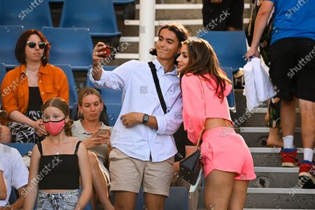 Vanessa Sierra, girlfriend of Bernard Tomic of Australia takes a selfie with fans after his second round men's singles loss against Denis Shapovalov of Canada on Day 3 of the Australian Open Grand Slam tennis tournament in Melbourne, Australia, 10 February 2021.