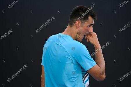 Bernard Tomic of Australia reacts during his second Round Men's singles match against Denis Shapovalov of Canada on Day 3 of the Australian Open Grand Slam tennis tournament in Melbourne, Australia, 10 February 2021.