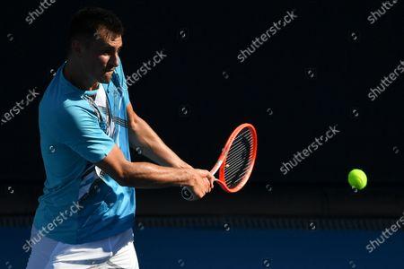 Bernard Tomic of Australia in action against Denis Shapovalov of Canada during their second round men's singles match on Day 3 of the Australian Open Grand Slam tennis tournament in Melbourne, Australia, 10 February 2021.