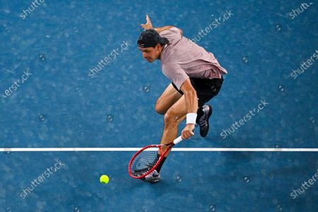 Alex Bolt of Australia in action during his second Round Men's singles match against Grigor Dimitrov of Bulgaria on Day 3 of the Australian Open at Melbourne Park in Melbourne, Australia, 10 February 2021.