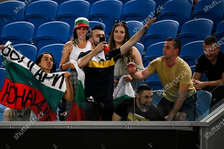 Bulgarian fans cheer for Grigor Dimitrov of Bulgaria during his second Round Men's singles match against Alex Bolt of Australia on Day 3 of the Australian Open at Melbourne Park in Melbourne, Australia, 10 February 2021.