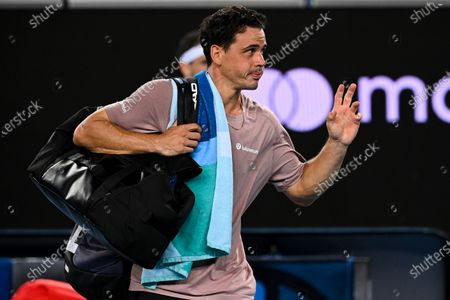 Alex Bolt of Australia leaves the court after loosing his second Round Men's singles match against Grigor Dimitrov of Bulgaria on Day 3 of the Australian Open at Melbourne Park in Melbourne, Australia, 10 February 2021.
