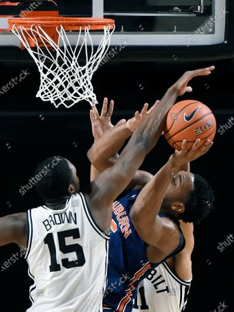 Auburn forward Chris Moore, right, has his shot blocked by Vanderbilt forward Clevon Brown (15) during the first half of an NCAA college basketball game, in Nashville, Tenn