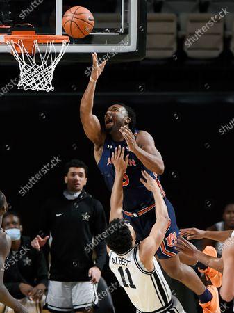 Auburn forward Chris Moore (5) goes the basket against Vanderbilt guard Braelee Albert (11) during the first half of an NCAA college basketball game, in Nashville, Tenn