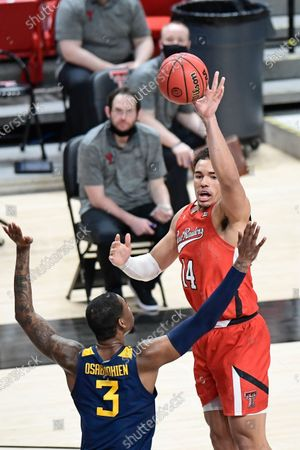 Texas Tech's Marcus Santos-Silva (14) passes the ball during the second half of an NCAA college basketball game against West Virginia in Lubbock, Texas