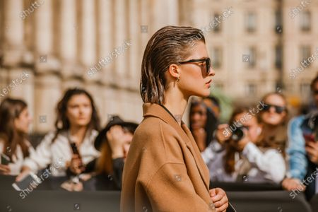 Model Julia Van Os wears a camel coat, seen outside Balmain show during Paris Fashion Week Womenswear Spring Summer 2019