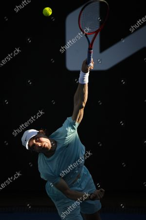 Stock Image of Canada's Denis Shapovalov serves to Australia's Bernard Tomic during their second round match at the Australian Open tennis championship in Melbourne, Australia