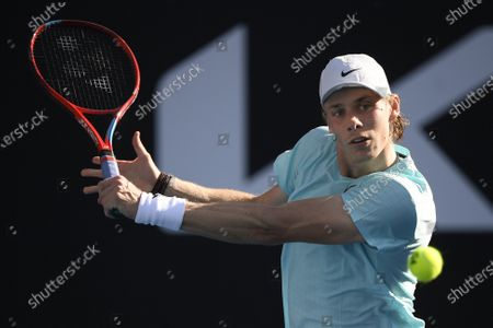 Stock Photo of Canada's Denis Shapovalov makes a backhand return to Australia's Bernard Tomic during their second round match at the Australian Open tennis championship in Melbourne, Australia