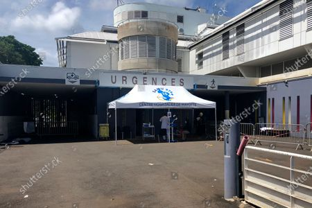 Stock Photo of Tent is set up at the entrance of the emergency service of the Mayotte hospital, Sunday Feb.7, 2021. The Mayotte islands are the poorest corner of the European Union, tucked between Madagascar and the mainland coast of Mozambique in southern Africa, and the last spot in the bloc to receive any coronavirus vaccines. Local authorities feel forgotten, and say their difficulties in fighting the virus reflect long-standing inequalities between France's majority-white mainland and its far-flung former colonies where most people are of color