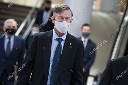 Sen. John Hickenlooper, D-Colo., is seen in the senate subway after the first day of the impeachment trial of former President Trump in the Capitol in Washington, DC