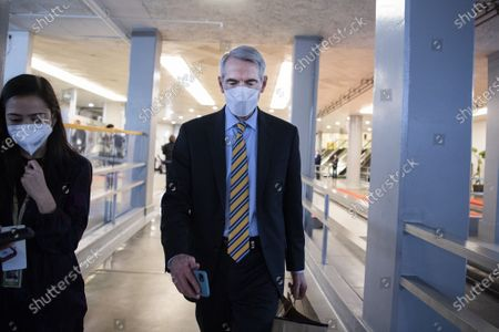 Sen. Robert Portman, R-Ohio, is seen in the senate subway after the first day of the impeachment trial of former President Trump in the Capitol in Washington, DC