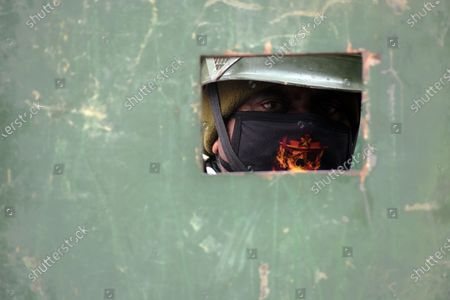 A paramilitary soldier looks from inside the bunker in city center Lal Chowk in Srinagar, Kashmir on February 09, 2021. Shops and business establishments remain closed in Srinagar on the 8th death anniversary of Afzal Guru who was secretly hanged in New Delhi's Tihar jail 0n February 09, 2031 for his alleged role in Indian parliament attack. (Photo by Faisal Khan/NurPhoto)