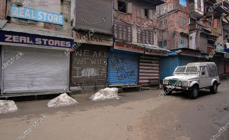 Stock Image of A paramilitary vehicle moves through a closed market in Srinagar, Kashmir on February 09, 2021. Shops and business establishments remain closed in Srinagar on the 8th death anniversary of Afzal Guru who was secretly hanged in New Delhi's Tihar jail 0n February 09, 2031 for his alleged role in Indian parliament attack. (Photo by Faisal Khan/NurPhoto)