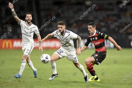 Jake Brimmer of Melbourne Victory under pressure from Graham Dorrans of Western Sydney Wanderers; Bankwest Stadium, Parramatta, New South Wales, Australia; A League Football, Western Sydney Wanderers versus Melbourne Victory.