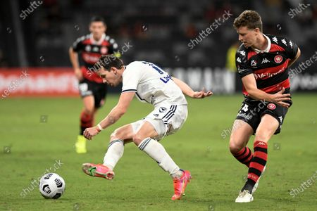 Robbie Kruse of Melbourne Victory is bundled off the ball by Patrick Ziegler of Western Sydney Wanderers; Bankwest Stadium, Parramatta, New South Wales, Australia; A League Football, Western Sydney Wanderers versus Melbourne Victory.