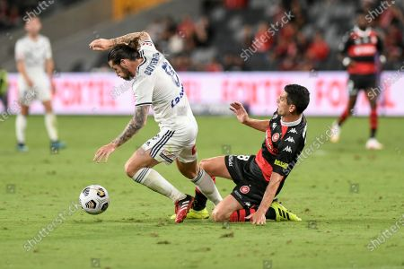 Jacob Butterfield of Melbourne Victory is tackled by Graham Dorrans of Western Sydney Wanderers; Bankwest Stadium, Parramatta, New South Wales, Australia; A League Football, Western Sydney Wanderers versus Melbourne Victory.