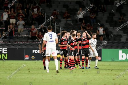 the Wanderers celebrate after Graham Dorrans of Western Sydney Wanderers scores from the penalty spot in the 72nd minute to make it 1-0; Bankwest Stadium, Parramatta, New South Wales, Australia; A League Football, Western Sydney Wanderers versus Melbourne Victory.