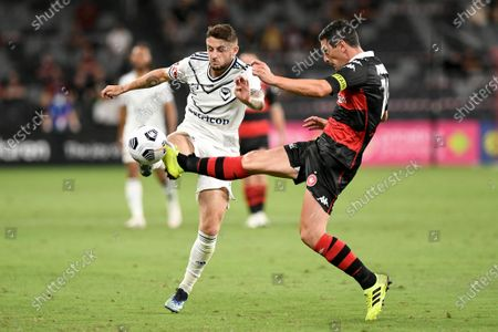 Graham Dorrans of Western Sydney Wanderers tackles Jake Brimmer of Melbourne Victory; Bankwest Stadium, Parramatta, New South Wales, Australia; A League Football, Western Sydney Wanderers versus Melbourne Victory.