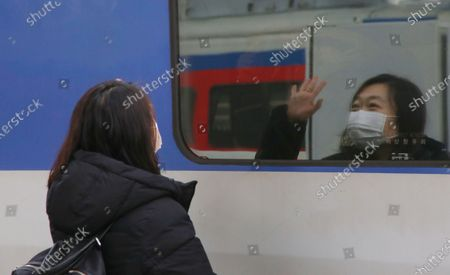 A woman see off as his family to board a train to go their hometown, in preparation for the traditional Korean holiday of Lunar New Year, at the Seoul station in Seoul, South Korea, 10 February 2021 ahead of the Lunar New Year's holiday, which falling from 11 to 14 February 2021. Lunar New Year is one of Korea's major traditional holidays. Many Koreans, during the festivities, will take long trips to their hometowns to visit family and pay homage to their ancestors.