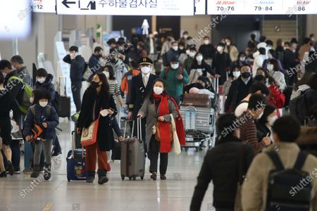 People prepare to board a plane to go their hometown in preparation for the traditional Korean holiday of Lunar New Year at the Kimpo airport in Seoul, South Korea, 10 February 2021 ahead of the Lunar New Year's holiday, which falling from 11 to 14 February 2021. Lunar New Year is one of Korea's major traditional holidays. Many Koreans, during the festivities, will take long trips to their hometowns to visit family and pay homage to their ancestors.