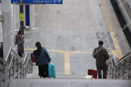 South Korean people are waiting to board a train to go their hometown, in preparation for the traditional Korean holiday of Lunar New Year, at the Seoul station in Seoul, South Korea, 10 February 2021 ahead of the Lunar New Year's holiday, which falling from 11 to 14 February 2021. Lunar New Year is one of Korea's major traditional holidays. Many Koreans, during the festivities, will take long trips to their hometowns to visit family and pay homage to their ancestors.