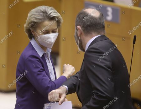 Stock Image of European Commission President Ursula von der Leyen (L) and leader of the European People's Party at the European Parliament Manfred Weber ellbow check ahead of the debate on the state of play of the EU's Covid-19 vaccination strategy during a plenary session of the European Parliament, in Brussels, Belgium, 10 February 2021.