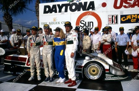 Stock Picture of Race winners (L to R): Jan Lammers (NED) / Andy Wallace (GBR) / Davy Jones (USA), Jaguar XJR-12 (Car #61, chassis #388), celebrate in victory lane.IMSA, Rd1, Daytona 24 Hours, Florida, USA. 3-4 February 1990.