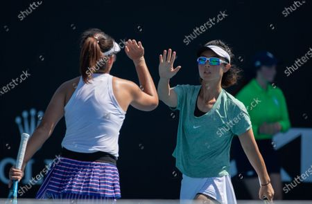 Yang Zhaoxuan/Xu Yifan (R) react during the women's doubles first round match between Yang Zhaoxuan/Xu Yifan of China and Russia's Anastasia Pavlyuchenkova/Latvia's Anastasija Sevastova at the Australian Open in Melbourne Park, Melbourne, Australia on Feb. 10, 2021.