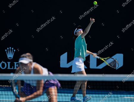 Yang Zhaoxuan/Xu Yifan (R) compete during the women's doubles first round match between Yang Zhaoxuan/Xu Yifan of China and Russia's Anastasia Pavlyuchenkova/Latvia's Anastasija Sevastova at the Australian Open in Melbourne Park, Melbourne, Australia on Feb. 10, 2021.