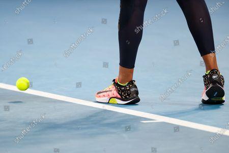 Osaka Naomi of Japan serves during the women's singles match against Caroline Garcia of France at Australian Open in Melbourne Park, in Melbourne, Australia, on Feb. 10, 2021.