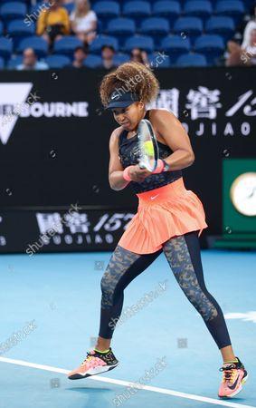 Osaka Naomi of Japan returns a shot during the women's singles match against Caroline Garcia of France at Australian Open in Melbourne Park, in Melbourne, Australia, on Feb. 10, 2021.