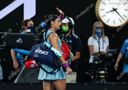 Caroline Garcia of France greets after the women's singles match against Osaka Naomi of Japan at Australian Open in Melbourne Park, in Melbourne, Australia, on Feb. 10, 2021.