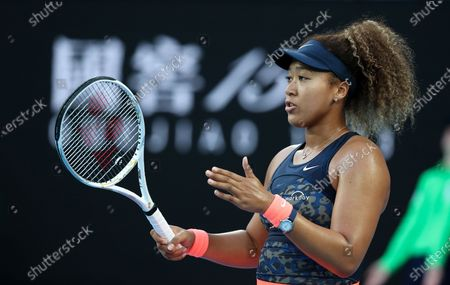 Osaka Naomi of Japan reacts during the women's singles match against Caroline Garcia of France at Australian Open in Melbourne Park, in Melbourne, Australia, on Feb. 10, 2021.