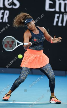 Osaka Naomi of Japan returns a shot during the women's singles match against Caroline Garcia of France at Australian Open in Melbourne Park, in Melbourne, Australia, on Feb. 10, 2021.