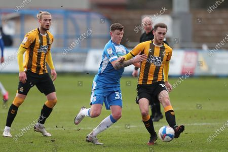 Adam May of Cambridge United in action with Dion Donohue of Barrow   during the Sky Bet League 2 match between Barrow and Cambridge United at the Holker Street, Barrow-in-Furness on Saturday 6th February 2021. (Photo by Mark Fletcher/MI News/NurPhoto)