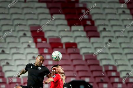 Stock Photo of Ricardo Quaresma of Vitoria SC (L) vies with Julian Weigl of SL Benfica during the Portuguese League football match between SL Benfica and Vitoria SC at the Luz stadium in Lisbon, Portugal on February 5, 2021. (Photo by Pedro Fiúza/NurPhoto)