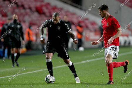 Stock Image of Ricardo Quaresma of Vitoria SC (L) vies with Julian Weigl of SL Benfica during the Portuguese League football match between SL Benfica and Vitoria SC at the Luz stadium in Lisbon, Portugal on February 5, 2021. (Photo by Pedro Fiúza/NurPhoto)